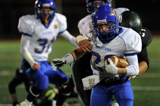Queensbury's Kody Bruno, right, carries the ball during their Class A state semifinal football game against Cornwall on Friday, Nov. 22, 2013, at Dietz Stadium in Kingston, N.Y. (Cindy Schultz / Times Union) Photo: Cindy Schultz / 00024745A
