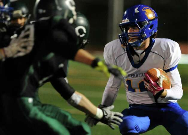 Queensbury's Timothy Voorhis, right, carries the ball during their Class A state semifinal football game against Cornwall on Friday, Nov. 22, 2013, at Dietz Stadium in Kingston, N.Y. (Cindy Schultz / Times Union) Photo: Cindy Schultz / 00024745A