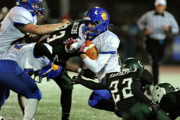 Queensbury's Timothy Voorhis, center, carries the ball during their Class A state semifinal football game against Cornwall on Friday, Nov. 22, 2013, at Dietz Stadium in Kingston, N.Y. (Cindy Schultz / Times Union) Photo: Cindy Schultz / 00024745A