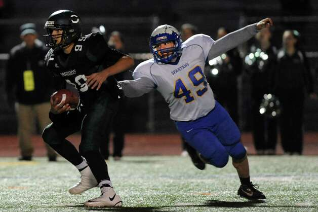 Queensbury's Francis Nassivera, right, pressures Cornwall quarterback Jason Bailey during their Class A state semifinal football game on Friday, Nov. 22, 2013, at Dietz Stadium in Kingston, N.Y. (Cindy Schultz / Times Union) Photo: Cindy Schultz / 00024745A