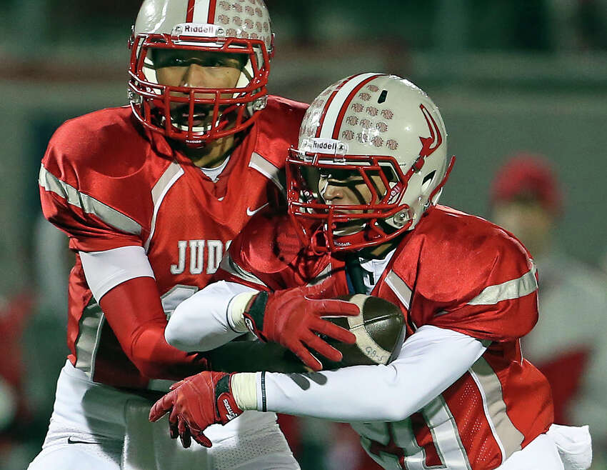 Rayjohn Austin-Ramsey hands off to Brandon Sanders as Judson plays Warren in the second round of 5A football playoffs at Rutledge Stadium on November 22, 2013.