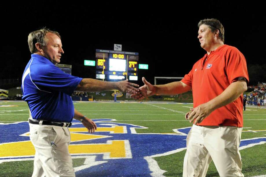 McNeese head coach Matt Viator (left) congratulates Lamar head coach Ray Woodard after the Cardinals 30-27 loss against McNeese State at Cowboy Stadium in Lake Charles in 2010.   Enterprise file photo Photo: Valentino Mauricio / Beaumont