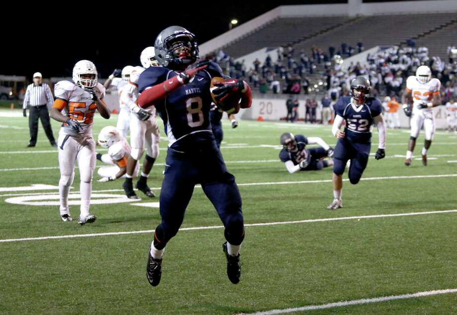 Jamond Manuel jumps for joy as he scores the winning touchdown for Manvel with six seconds remaining. Manuel had three receptions, scoring on two of them. Photo: Thomas B. Shea / © 2013 Thomas B. Shea