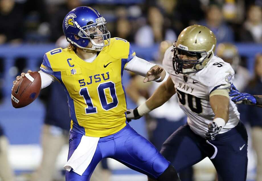 San Jose State quarterback David Fales (10) throws under pressure from Navy defensive end Will Anthony, right, during the first half of an NCAA college football game on Friday, Nov. 22, 2013, in San Jose, Calif. (AP Photo/Marcio Jose Sanchez) Photo: Marcio Jose Sanchez, Associated Press