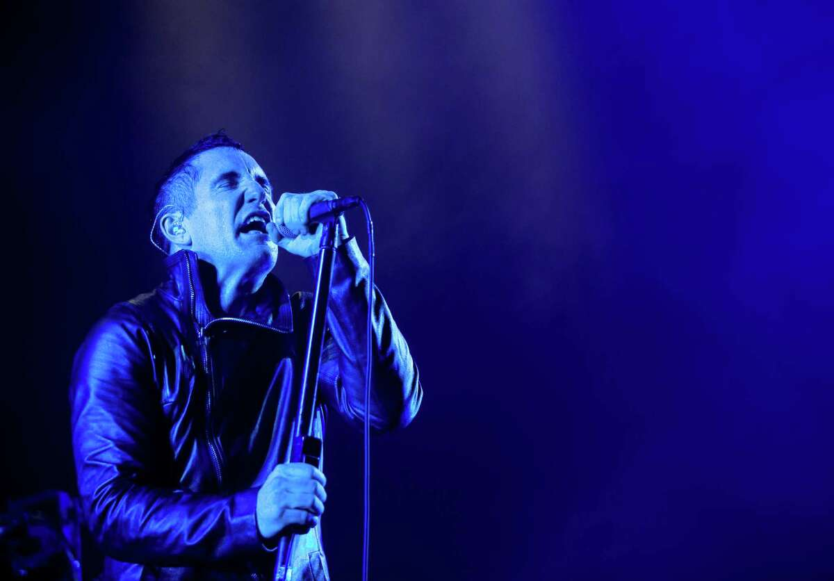 Trent Reznor, frontman of Nine Inch Nails, performs during the