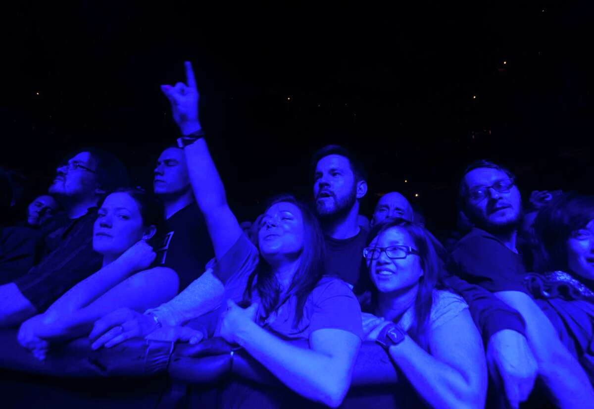Fan watch as the band Nine Inch Nails performs during the