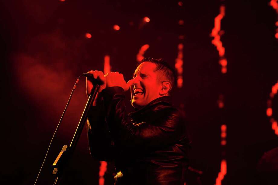 "Trent Reznor, frontman of Nine Inch Nails, performs during the ""Tension 2013"" tour on Friday, Nov. 22, 2013, at KeyArena in Seattle. The ""Tension 2013"" tour marked the first time Nine Inch Nails has been on the road since 2009. Photo: Sofia Jaramillo, SEATTLEPI.COM / SEATTLEPI.COM"