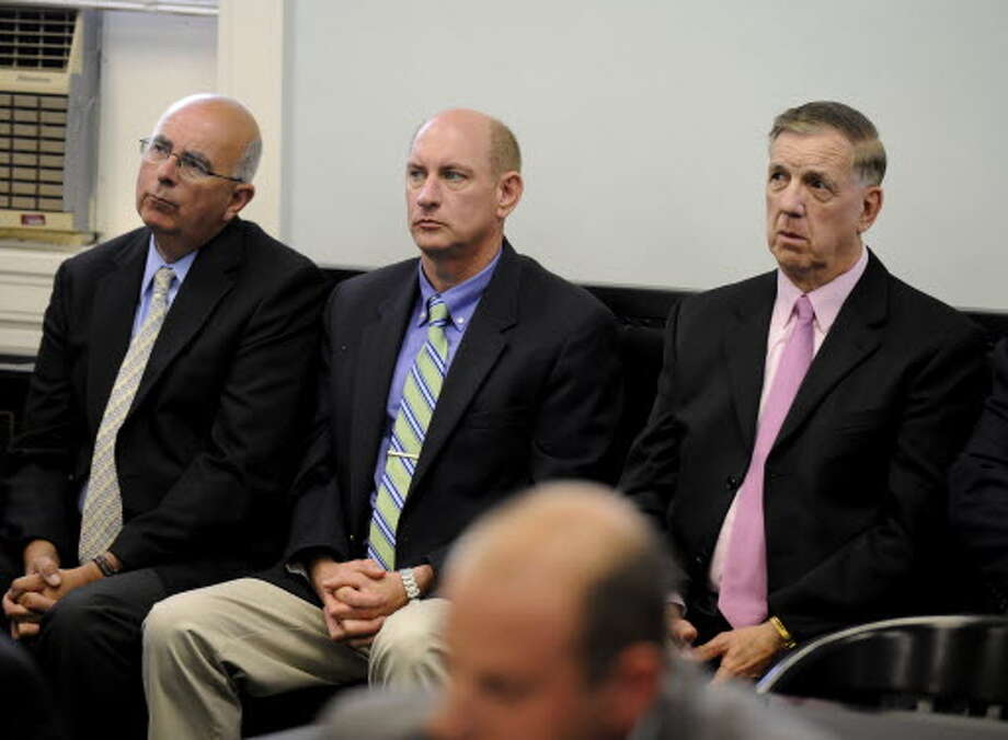 Saratoga County sheriff's investigators Mike Zurlo, left, and Kevin Mullahey, center, sit with Sheriff James Bowen during a defendant's sentencing in the Columbia County Courthouse in Hudson. Zurlo was elected sheriff on Nov. 5, 2013, and he will name Mullahey as his undersheriff. Bowen will retire at year's end. (Times Union archive)