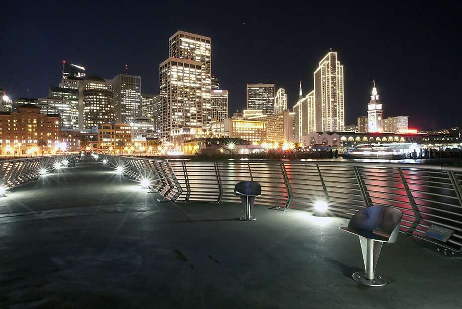 Viewed from Pier 14, the Embarcadero Center lights up their buildings with an outline of white lights for the holidays in San Francisco, CA Friday, November 22, 2013. Photo: Michael Short, The Chronicle