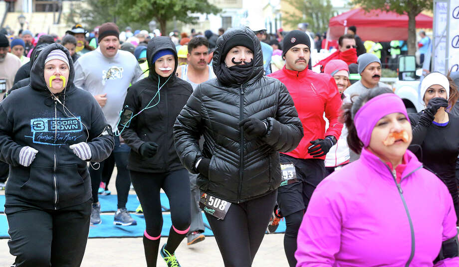 "The race begins as runners brave the cold wind to complete the  5K ""Mustache Dasche"" held at the Elian Hotel on La Cantera Parkway on November 23, 2013. Photo: TOM REEL"