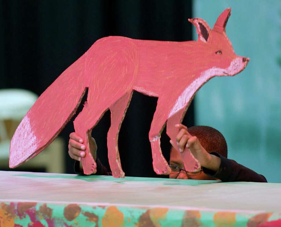 "Kyle McCollough, 10, uses a fox puppet to  tell the story ""Henny Penny"" as part of Tellebration!, on Saturday, November 23, 2013, at the Ellsworth Avenue School in Danbury, Conn. McCollough is in the 5th grade. Photo: H John Voorhees III / The News-Times Freelance"