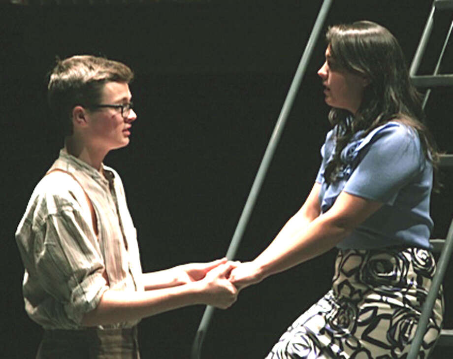 """Luke Wright and Tia Martino perform during rehearsal for Shepaug Dramatics' staging of """"Urinetown"""" at Shepaug Valley High School. November 2013 Photo: Contributed Photo / The News-Times Contributed"""