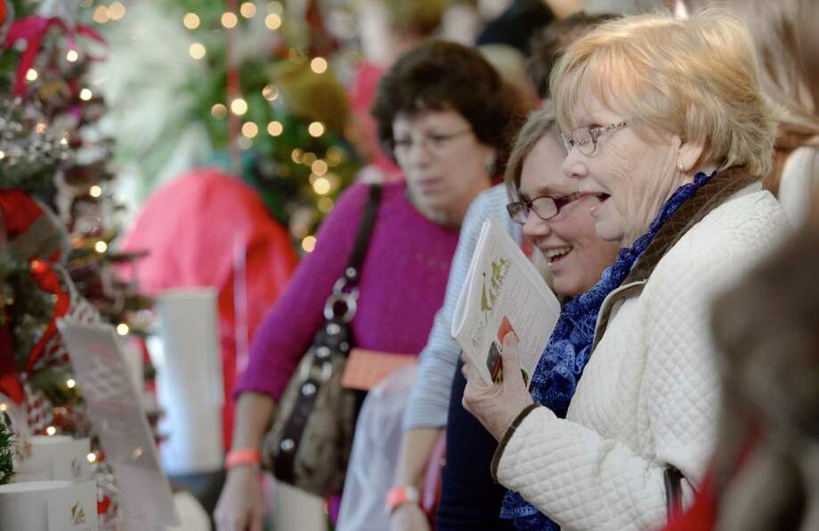 Jeanne Schipper, right, looks at decorated trees with her daughter Kim Moran, both from Danbury, during the Ann's Place Festival of Trees held at the Matrix Conference & Banquet Center in Danbury, Conn, on Saturday, November 23, 2013. The event continues on Sunday, 10 am to 5 pm. Photo: H John Voorhees III / The News-Times Freelance
