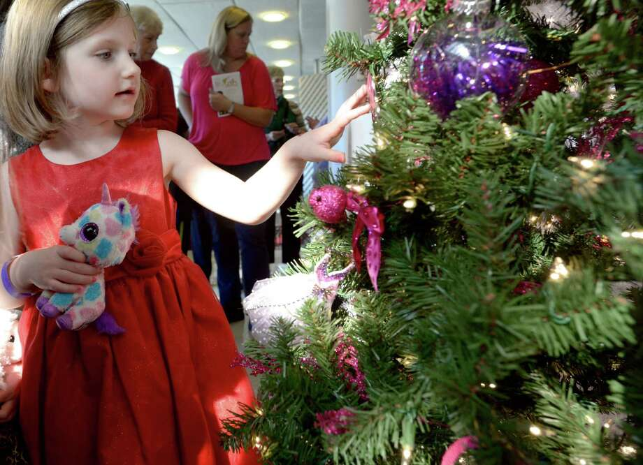 Kaidence Wright, 4, of Kent, looks at one of the many decorated trees on display during the Ann's Place Festival of Trees held at the Matrix Conference & Banquet Center in Danbury, Conn, on Saturday, November 23, 2013. The festival benefits Ann's Place, the Home of I Can cancer support services, in Danbury. Decorated trees are donated to be raffled. The event continues on Sunday, 10 am to 5 pm. Photo: H John Voorhees III / The News-Times Freelance