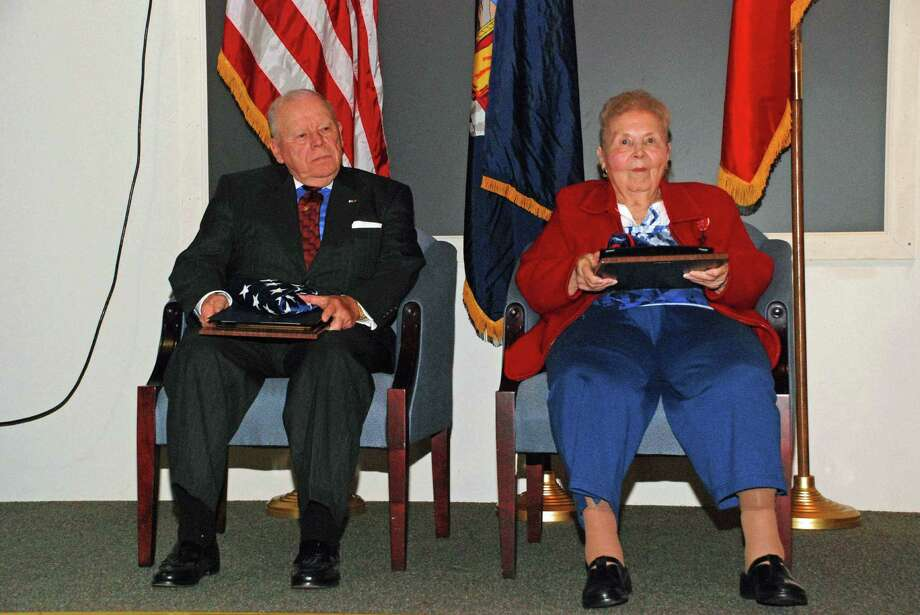 New York State Military Museum Calla Dever Osborne of Albany and James A. Haggerty of Valatie, hold the Veterans of the Year Awards they received at the New York State Military Museum and Veterans Research Center in Saratoga Springs.