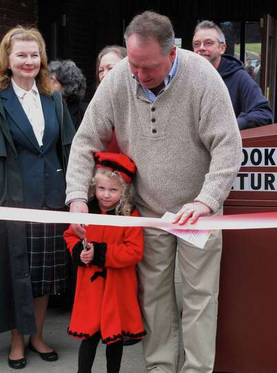 Julieanna Britton joins Berne Town Supervisor Kevin Crosier at a ribbon cutting Nov. 17 at the openi