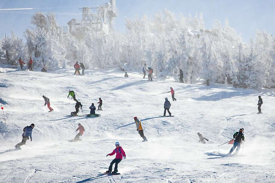Skiers enjoy the one open run at Heavenly Ski Resort, which added artificial snow on opening day in South Lake Tahoe. The season's first storm blanketed the slopes last week, leaving resort owners optimistic. Photo: Max Whittaker/Prime, Special To The Chronicle
