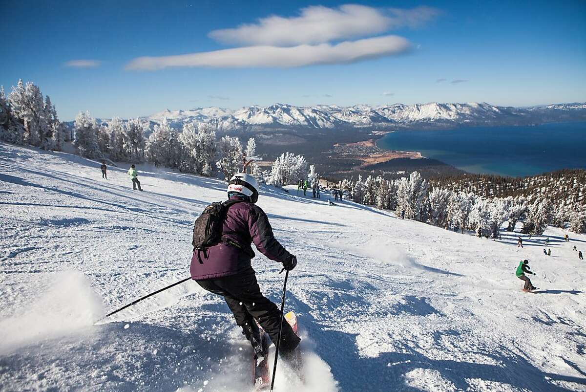 Skiers enjoy the one open run at Heavenly Ski Resort on opening day in South Lake Tahoe, California, November 23, 2013. While natural snow is still scarce, some resorts like Heavenly, are able to open before the Thanksgiving holiday by blowing artificial snow.