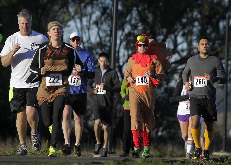 Dressed for the occasion, Chris McCarthy (149) runs in the first annual Napa Valley Turkey Trot 5K race in Napa, Calif. on Saturday, Nov. 23, 2013. Photo: Paul Chinn, The Chronicle