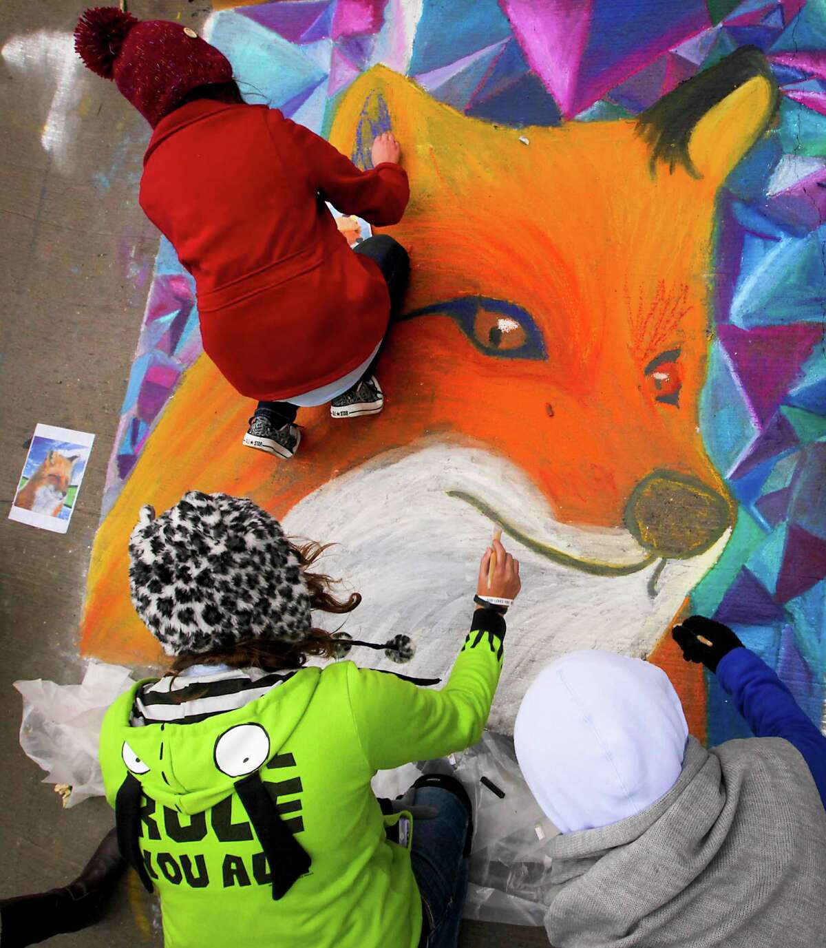 Artists work on an art piece at Via Colori. Proceeds from event benefit The Center for Hearing and Speech.