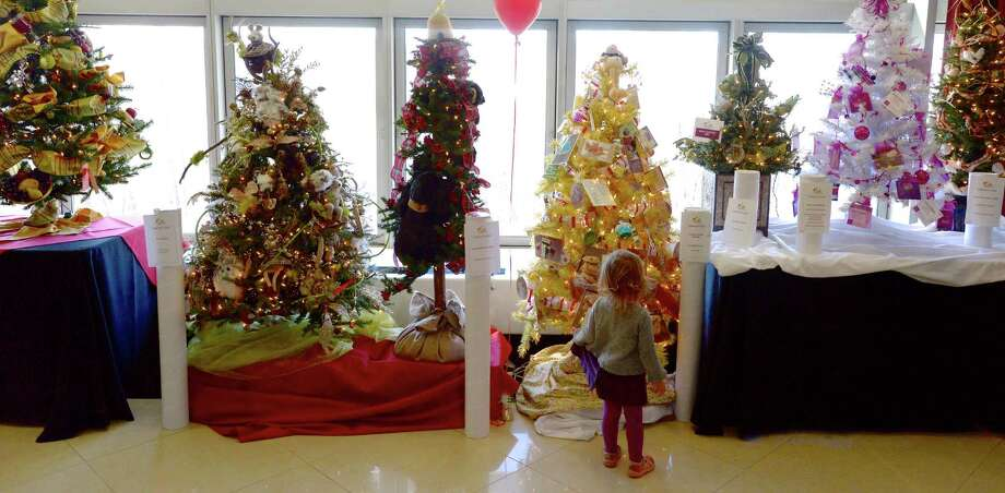 Mabel Mariano, 1 1/2, of Roxbury, looks at some of the trees on display at the Ann's Place Festival of Trees, held at the Matrix Conference & Banquet Center, Danbury. The event continues on Sunday,  10 am to 5 pm. Photo: H John Voorhees III / The News-Times Freelance