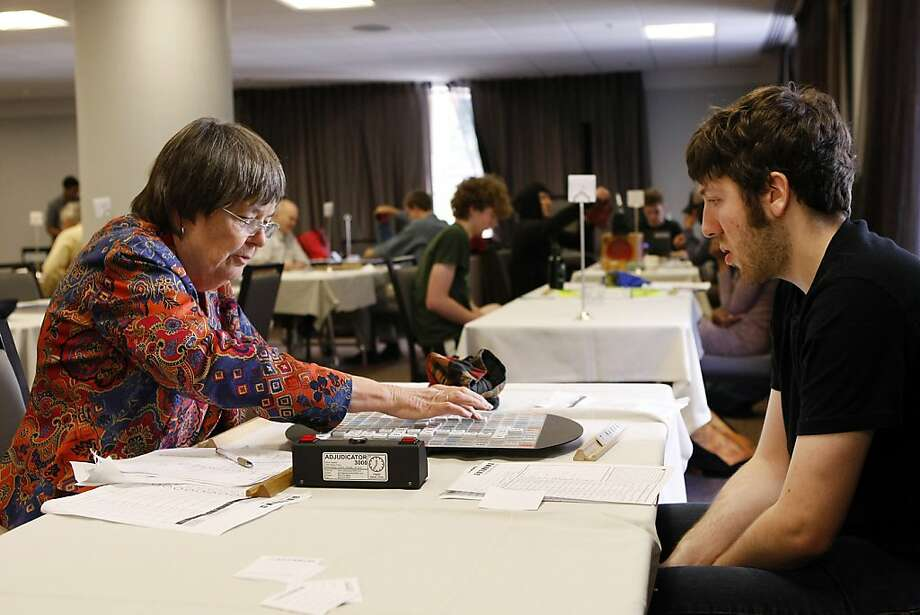 Elizabeth Ralston, left, plays a word against Rafi Stern during the 6th Annual California Open Scrabble Tournament at the Parc55 Wyndham Hotel in San Francisco, CA Saturday, November 23, 2013. Photo: Michael Short, The Chronicle