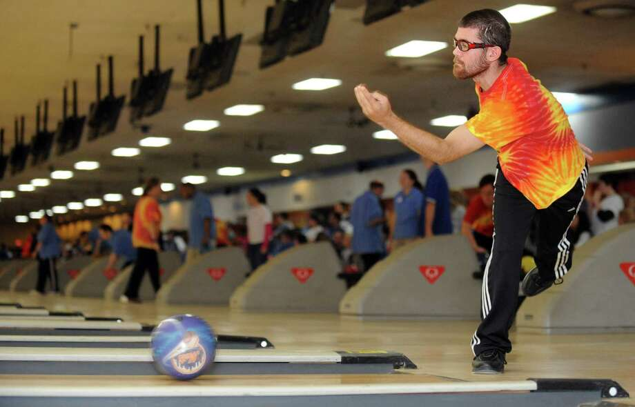 Timothy Schneider, of Bethel, bowls Saturday, Nov. 23, 2013 during the 2013 Holiday Sports Classic for Connecticut Special Olympics at AMF Lanes in Milford, Conn. Photo: Autumn Driscoll / Connecticut Post
