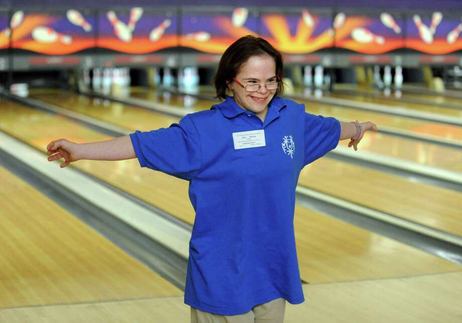 Ellen Meiring, of New Fairfield, celebrates with her team Saturday, Nov. 23, 2013 during the 2013 Holiday Sports Classic for Connecticut Special Olympics at AMF Lanes in Milford, Conn. Photo: Autumn Driscoll / Connecticut Post