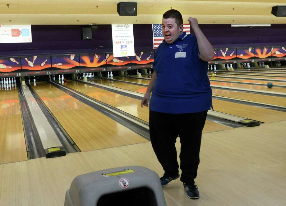 Sam Snyder, of Windham, bowls Saturday, Nov. 23, 2013 during the 2013 Holiday Sports Classic for Connecticut Special Olympics at AMF Lanes in Milford, Conn. Photo: Autumn Driscoll / Connecticut Post