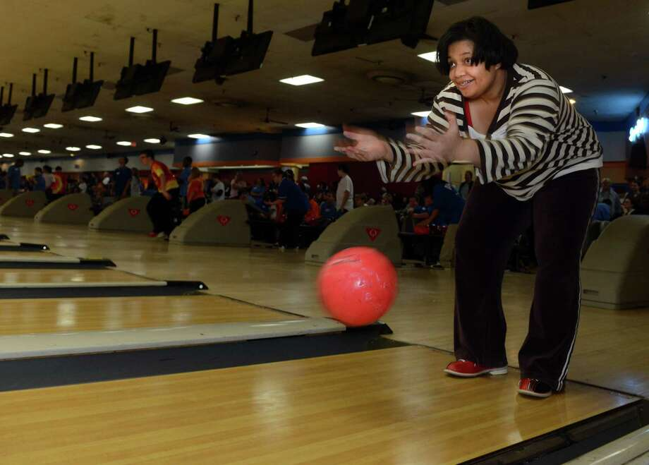 Shannon Donald, of Bridgeport, bowls Saturday, Nov. 23, 2013 during the 2013 Holiday Sports Classic for Connecticut Special Olympics at AMF Lanes in Milford, Conn. Photo: Autumn Driscoll / Connecticut Post