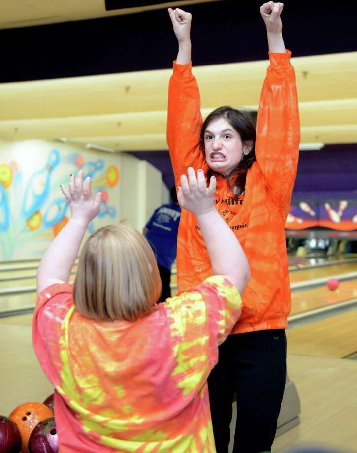 Sophie Legris, 16, of New Milford, celebrates after picking up a spare Saturday, Nov. 23, 2013 during the 2013 Holiday Sports Classic for Connecticut Special Olympics at AMF Lanes in Milford, Conn. Photo: Autumn Driscoll / Connecticut Post