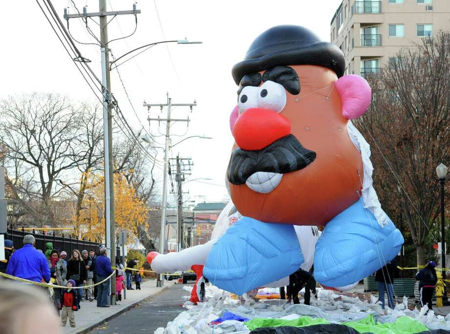 The Mr. Potato Head balloon gets inflated with helium during the annual SAC Capital Advisors balloon inflation party on Franklin Street in Stamford, Saturday afternoon, Nov. 23, 2013. The UBS Parade Spectacular begins at noon on Sunday, Nov. 24, at Summer and Hoyt streets and ends at Federal Street. Photo: Bob Luckey / Greenwich Time