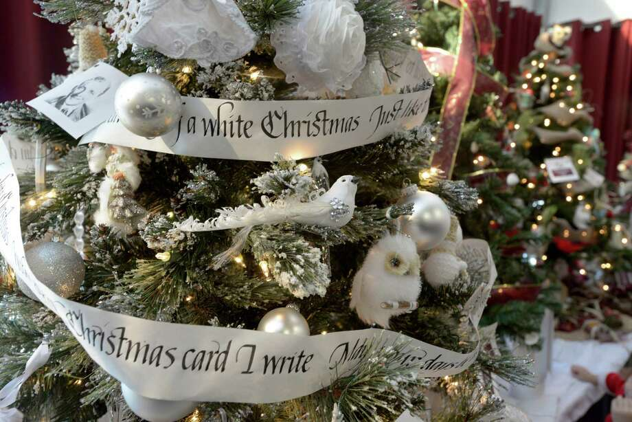 "One of the decorated trees, titled ""I'm Dreaming of a White Christmas"", at the Ann's Place Festival of Trees at the Matrix Conference & Banquet Center in Danbury, Conn, on Saturday, November, 23, 2013.  The event continues on Sunday, 10 am to 5 pm. Photo: H John Voorhees III / The News-Times Freelance"