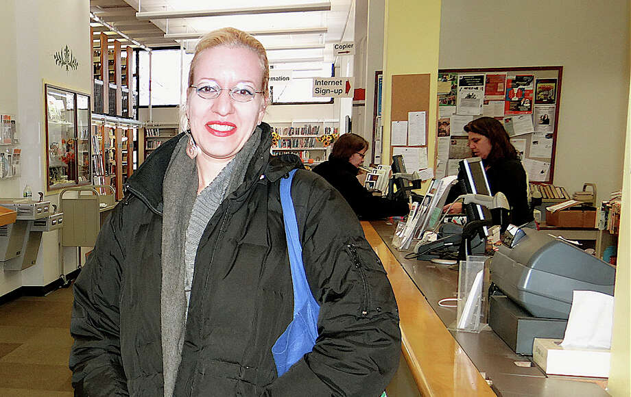 Sheri Haborak of Fairfield was among the first people to visit the Fairfield Woods Branch Library on Saturday morning after it reopened following a week-long mold remediation project. Photo: Mike Lauterborn / Fairfield Citizen contributed