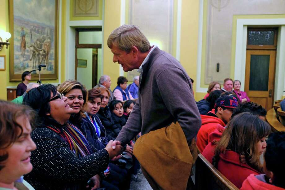 Rep. Scott Tipton  greets constituent Theresa Trujillo at a town hall meeting in Pueblo, Colo., this month. Tipton was elected in the tea party wave of 2010, but now faces the pressure of his district's demographics. Photo: MATTHEW STAVER, STR / NYTNS