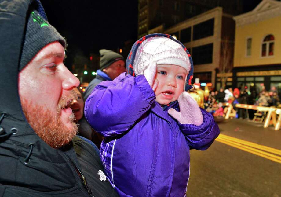 Brian Breana Nejman of Schenectady holds 17-month-old Breana Nejman during the 46th Annual Gazette Holiday Parade Saturday Nov. 23, 2013, in Schenectady, NY.  (John Carl D'Annibale / Times Union) Photo: John Carl D'Annibale / 00024398A