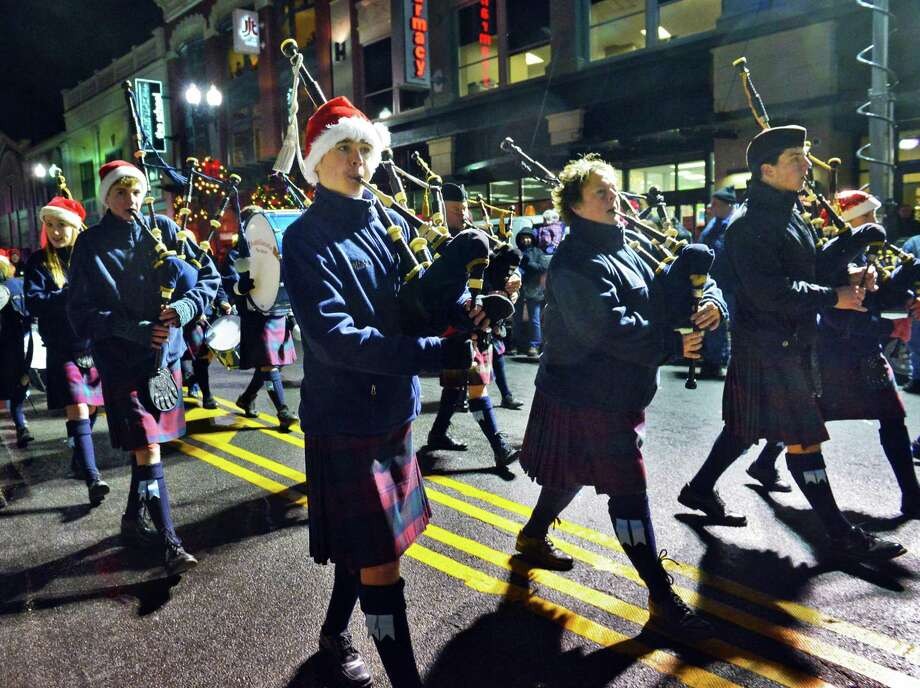 The Scotia Glenville Pipe Band performs during the 46th Annual Gazette Holiday Parade Saturday Nov. 23, 2013, in Schenectady, NY.  (John Carl D'Annibale / Times Union) Photo: John Carl D'Annibale / 00024398A