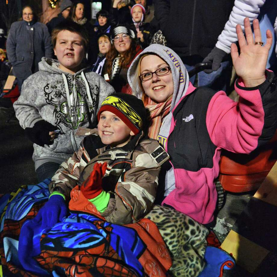 Amanda Fowler of Rotterdam with sons John Mancari, 10, left, and Tyler Fowler, 5 watch the 46th Annual Gazette Holiday Parade Saturday Nov. 23, 2013, in Schenectady, NY.  (John Carl D'Annibale / Times Union) Photo: John Carl D'Annibale / 00024398A