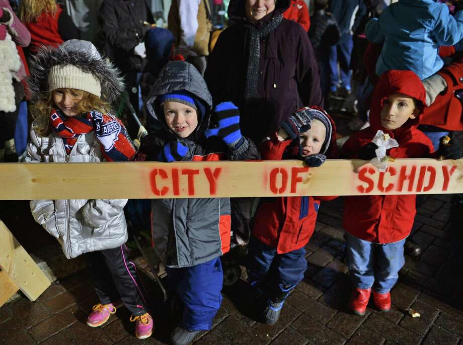 Watching the 46th Annual Gazette Holiday Parade are from left, Isabella Petrocci, 7 of Rotterdam, Jason and Peter, 2, Sievers of Clifton Park, and Teddy Sikora, 5 of Castleton and  Saturday Nov. 23, 2013, in Schenectady, NY.  (John Carl D'Annibale / Times Union) Photo: John Carl D'Annibale / 00024398A