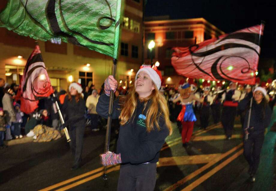 Willa Pisarski twirls a flag as she marches with the Schenectady Marching Band during the 46th Annual Gazette Holiday Parade Saturday Nov. 23, 2013, in Schenectady, NY.  (John Carl D'Annibale / Times Union) Photo: John Carl D'Annibale / 00024398A