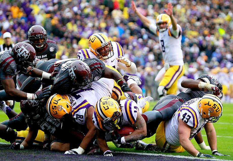 Terrence Magee, who ran for 149 of LSU's 324 rushing yards, bulls in for the Tigers' first touchdown. Photo: Sean Gardner, Getty Images