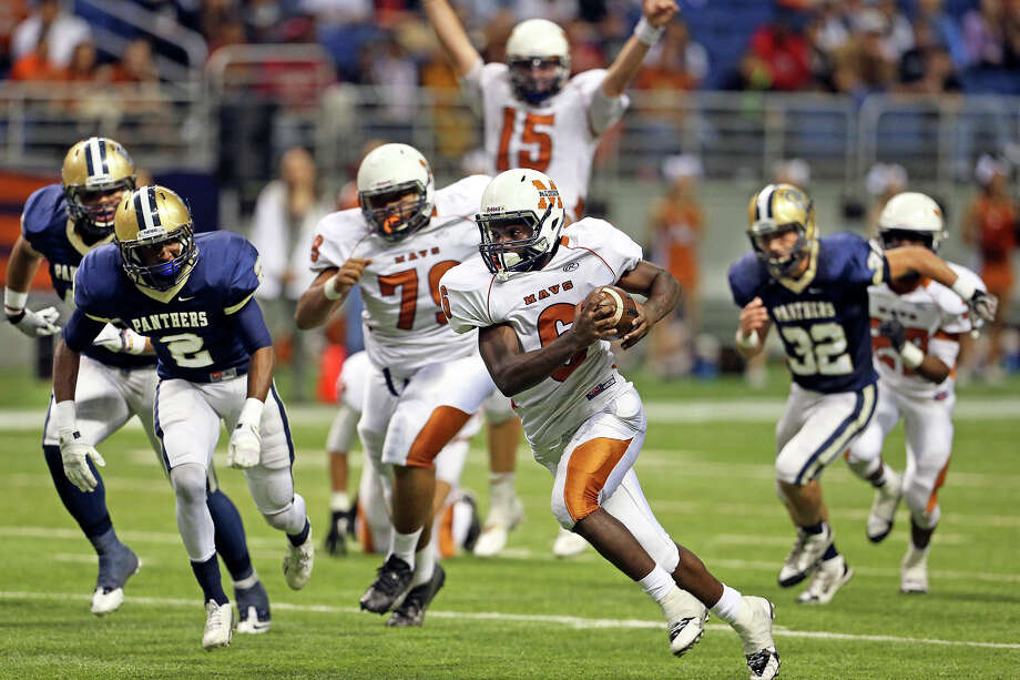 Dominique Daniels streaks for the end zone in the third quarter with quarterback Cody Ennis already celebrating the touchdown as Madison plays O'Connor in second round 5A football playoffs at the Alamodome on November 23, 2013. Photo: TOM REEL