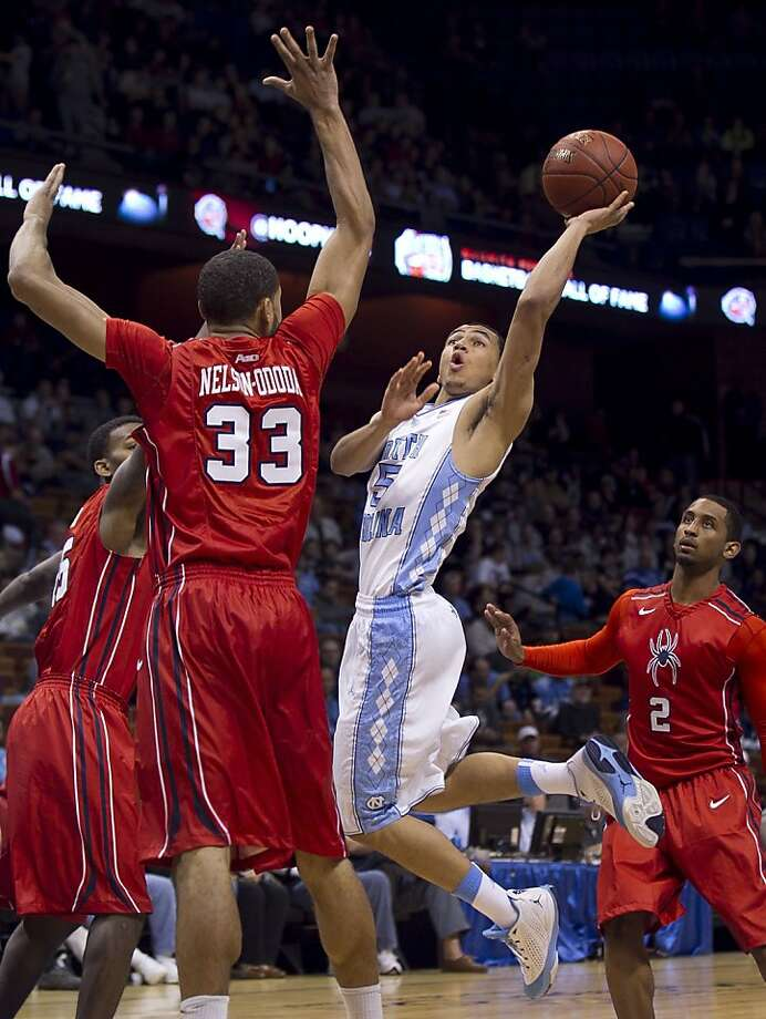 North Carolina's Marcus Paige, who scored 26 points, drives to the basket against Richmond's Alonzo Nelson-Ododa. Photo: Robert Willett, McClatchy-Tribune News Service