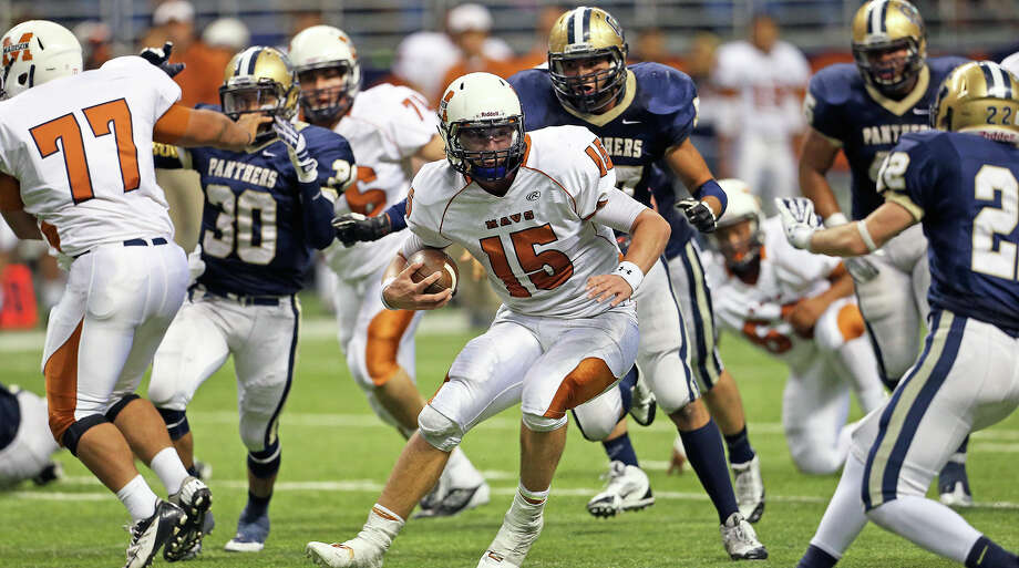 Maverick quarterback Cody Ennis heads for a third quarter touchdown as Madison plays O'Connor in second round 5A football playoffs at the Alamodome on November 23, 2013. Photo: TOM REEL