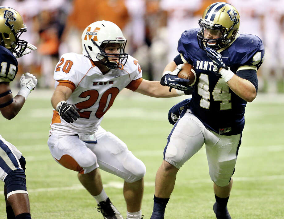 Panther running back Billy Craft rolls in the second half as Madison plays O'Connor in second round 5A football playoffs at the Alamodome on November 23, 2013. Photo: TOM REEL
