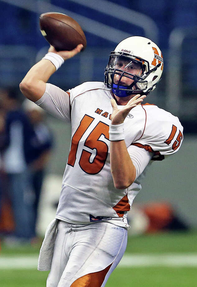Cody Ennis throws for the Mavericks as Madison plays O'Connor in second round 5A football playoffs at the Alamodome on November 23, 2013. Photo: TOM REEL