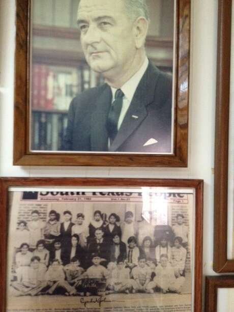 Photos of Lyndon B. Johnson as president and as a young teacher in Cotulla are on display at the Brush Country Museum in Cotulla. Photo: Joe Holley, Staff / Houston Chronicle