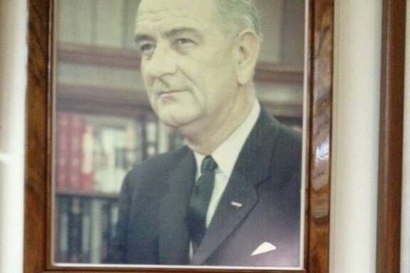 Photos of Lyndon B. Johnson as president and as a young teacher in Cotulla are on display at the Brush Country Museum in Cotulla.