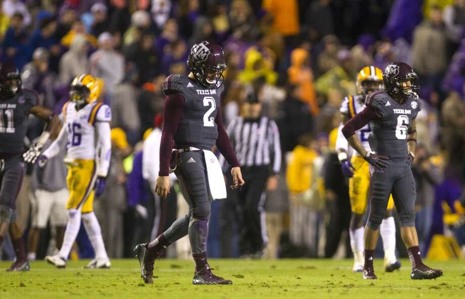 LSU 34, Texas A&M 10Record: 8-3  Texas A&M quarterback Johnny Manziel, left, and Texas A&M wide receiver LaQuvionte Gonzalez, right, walk off the field. Photo: Cody Duty, Houston Chronicle