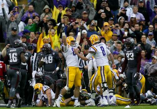 LSU tight end Logan Stokes, left, celebrates with LSU quarterback Zach Mettenberger, right, after the Tigers scored a touchdown. Photo: Cody Duty, Houston Chronicle